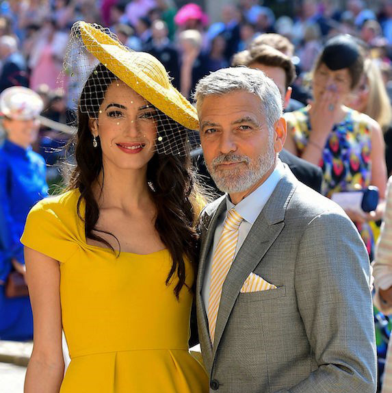George Clooney and Amal Alamuddin at an outdoor event, dressed up
