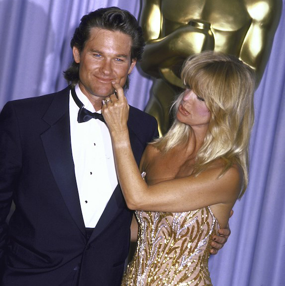 Goldie Hawn pinching Kurt Russell during an Academy Awards ceremony