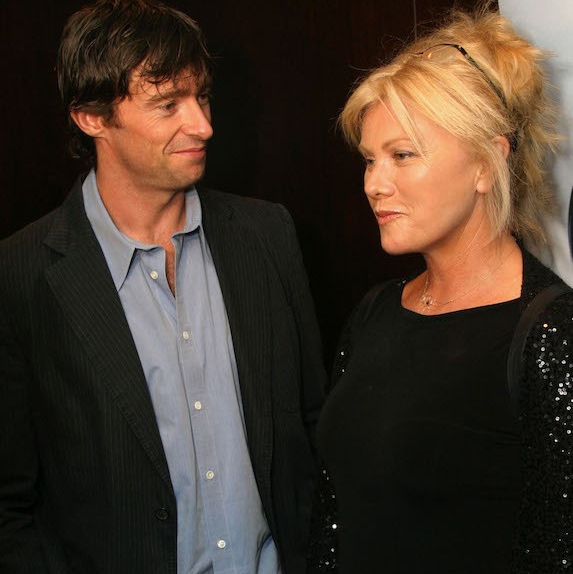 Hugh Jackman looking at Deborra Lee-Furness