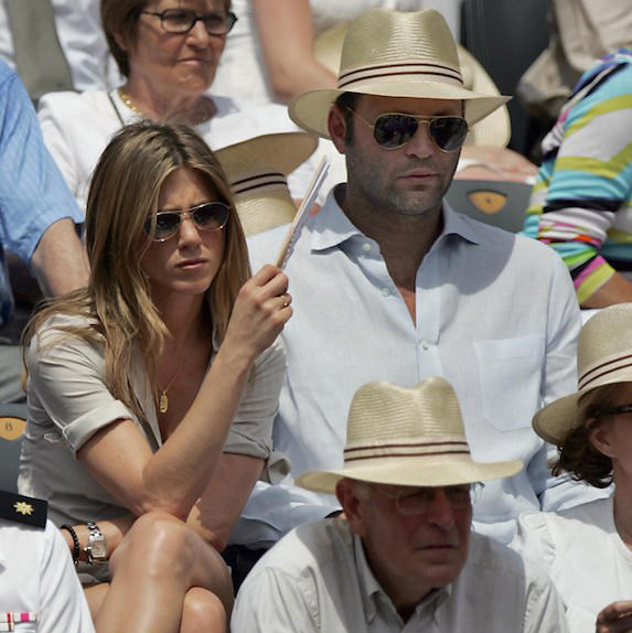 Jennifer Aniston and Vince Vaughan at an outdoor event mid-conversation