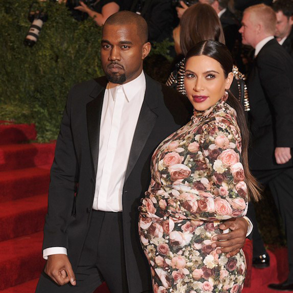 Kanye West with a pregnant Kim Kardashian at a formal event