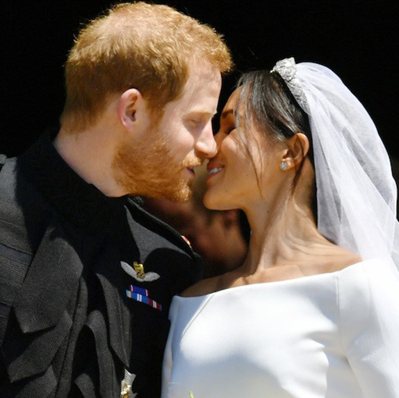 Prince Harry and Meghan Markle seal their wedding with a kiss