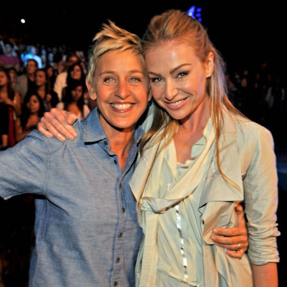 Ellen DeGeneres and Portia de Rossi holding each other