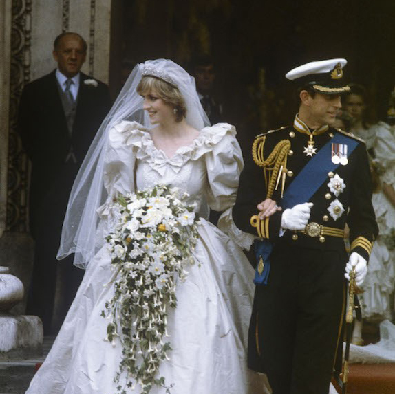 Prince Charles and Lady Diana walking out of their wedding ceremony