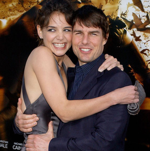 Tom Cruise and Katie Holmes hugging tightly