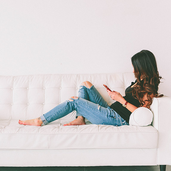 Girl sexting on the couch