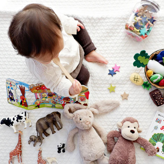 Small child plays with toys