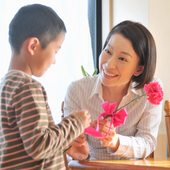 Child gives mother flowers