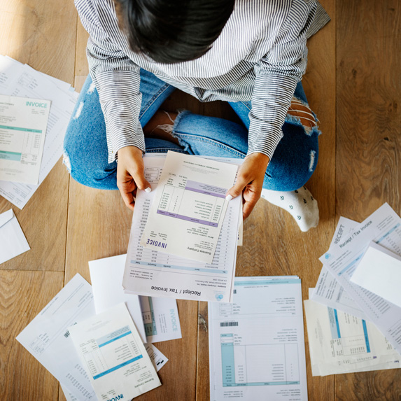 Person with financial paperwork