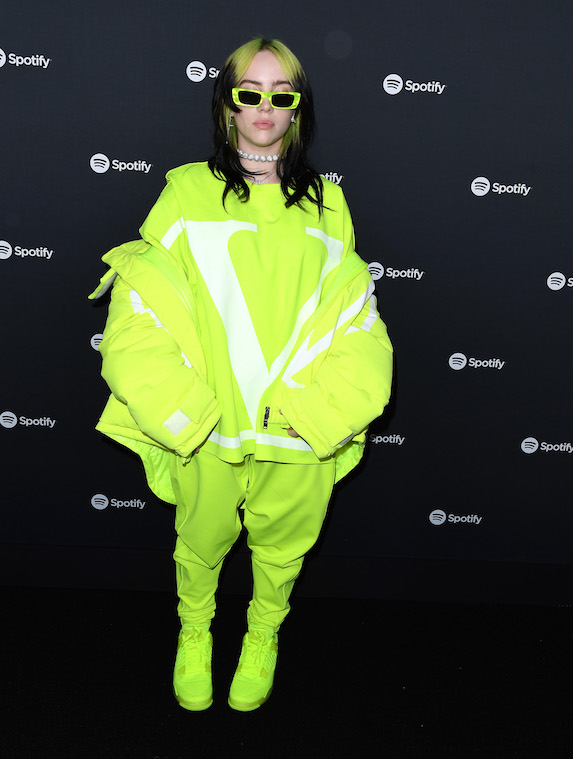 Billie Ellish wears head-to-toe oversized pieces in neon