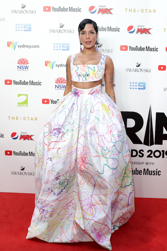 Halsey wears a crop top and voluminous ballgown skirt