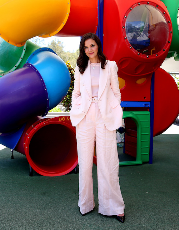 Katie Holmes wears a light-pink suit with wide-leg, oversized pants