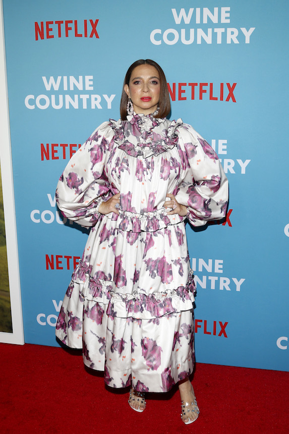 Maya Rudolph wears an oversized floral-print dress