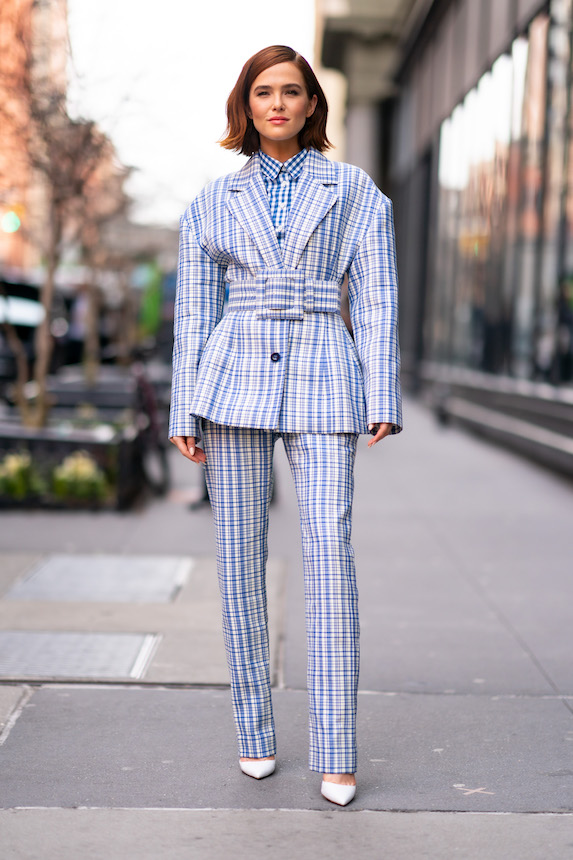 Zoey Deutch wears a suit in matching blue gingham print