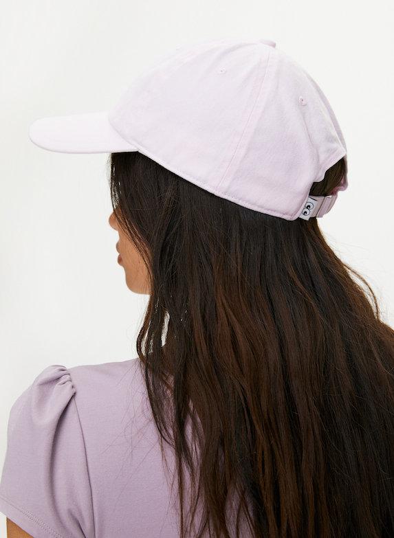 Model wears a pink baseball cap