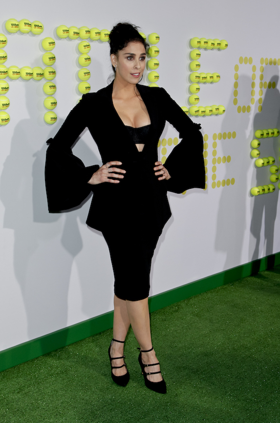 Sarah Silverman wears a black dress with bell sleeves