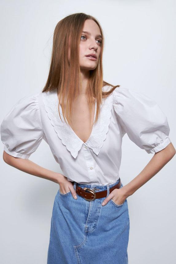 Model wears white blouse from Zara