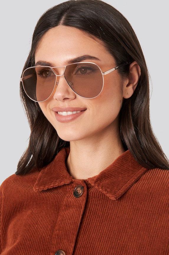 Model wears glasses from Nakd Fashion brand