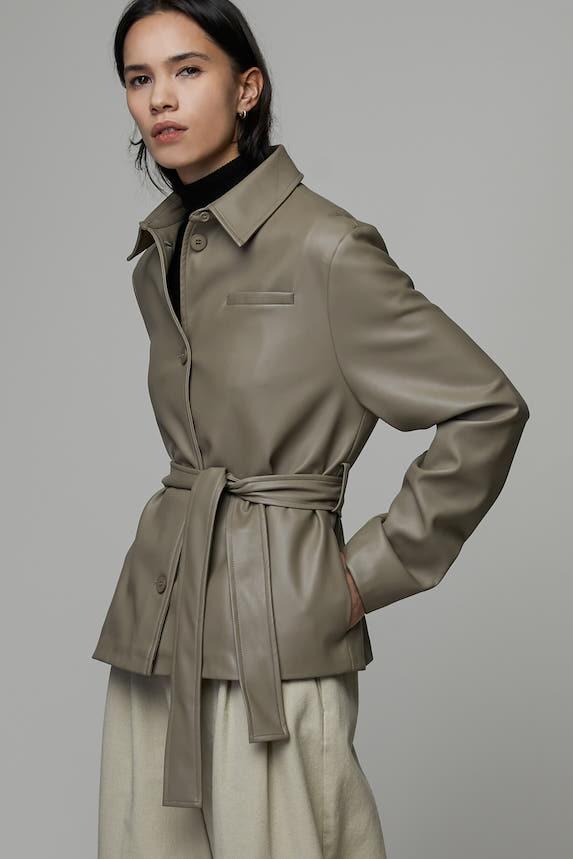 Model wears a green Oak+Fort jacket