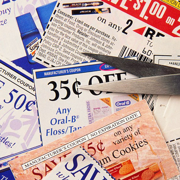 Various coupons scattered on a table