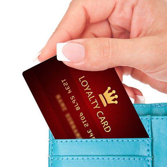 a hand removing a loyalty points card from their wallet