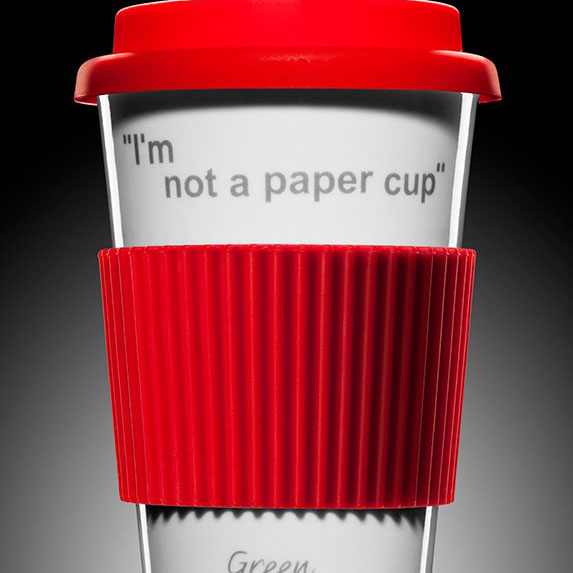 A red and white reusable travel mug