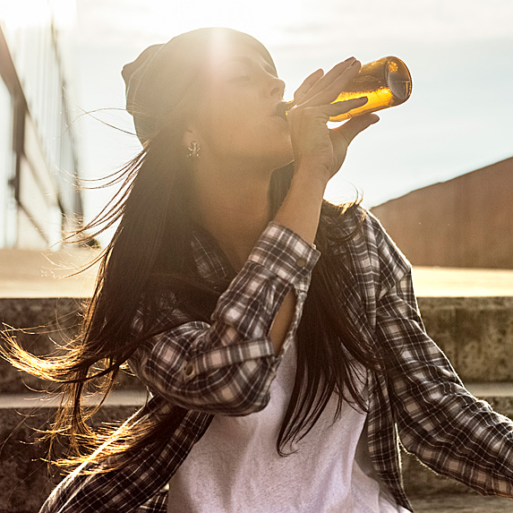 Woman drinking a bottle of beer