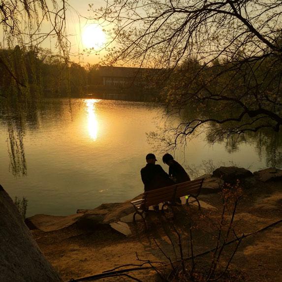 Couple sit by a lake