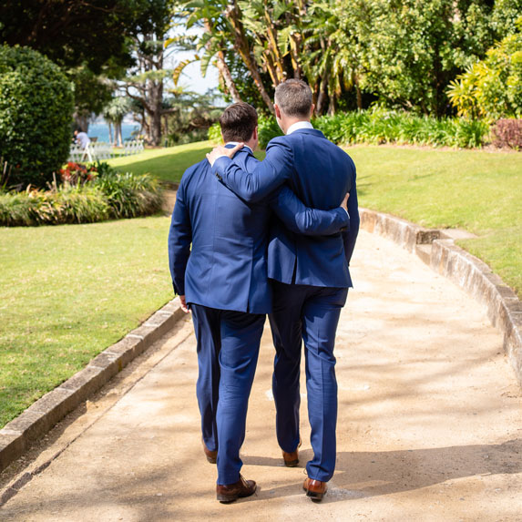 Men walking down a path
