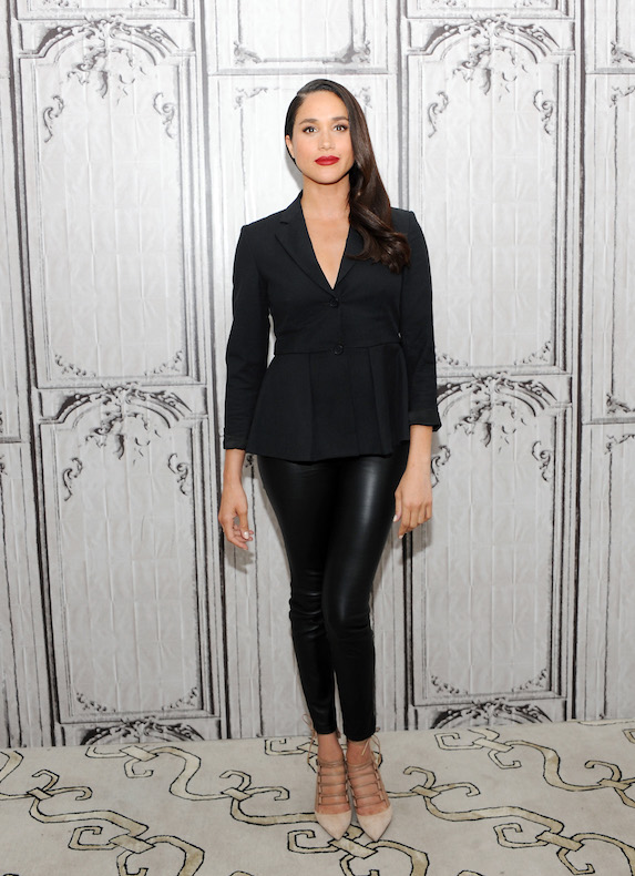 Meghan Markle wears a black pantsuit while at an event for AOL Studios in 2016