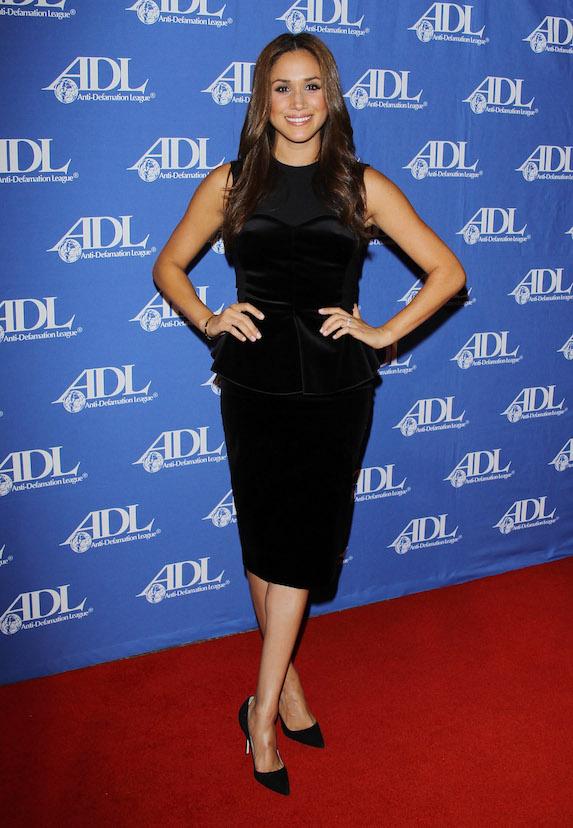 Meghan Markle wears a black midi dress with peplum waist to an event in 2011