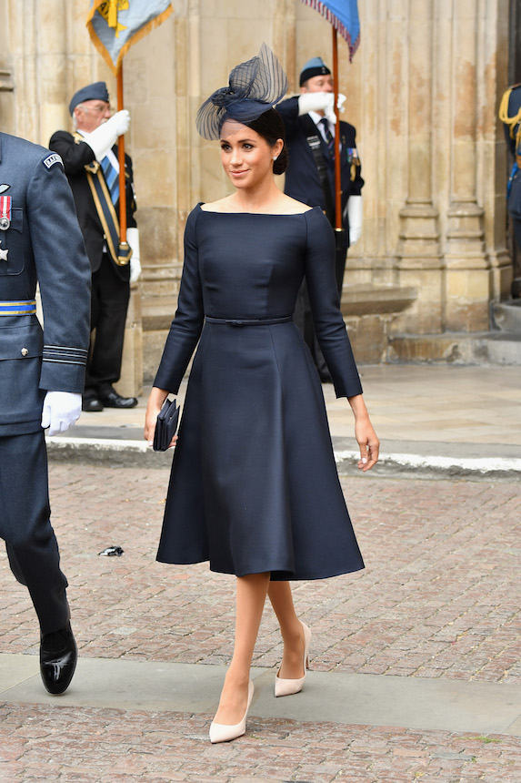 Meghan Markle wears a dark blue dress and coordinated fascinator while attending a royal engagement in 2018