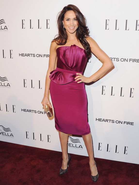 Meghan Markle wears a purple strapless midi dress at an event in 2013