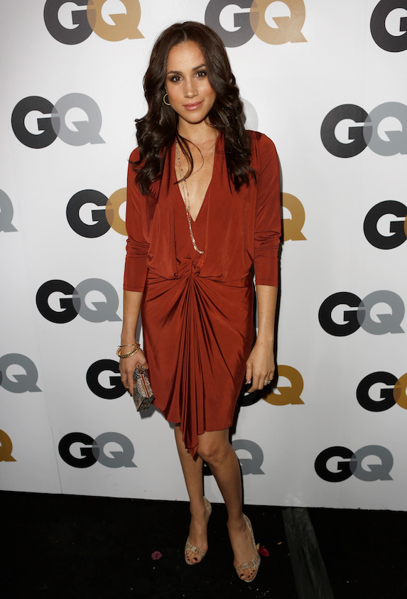 Meghan Markle wears a slinky red midi dress on the red carpet at an event for GQ on 2012
