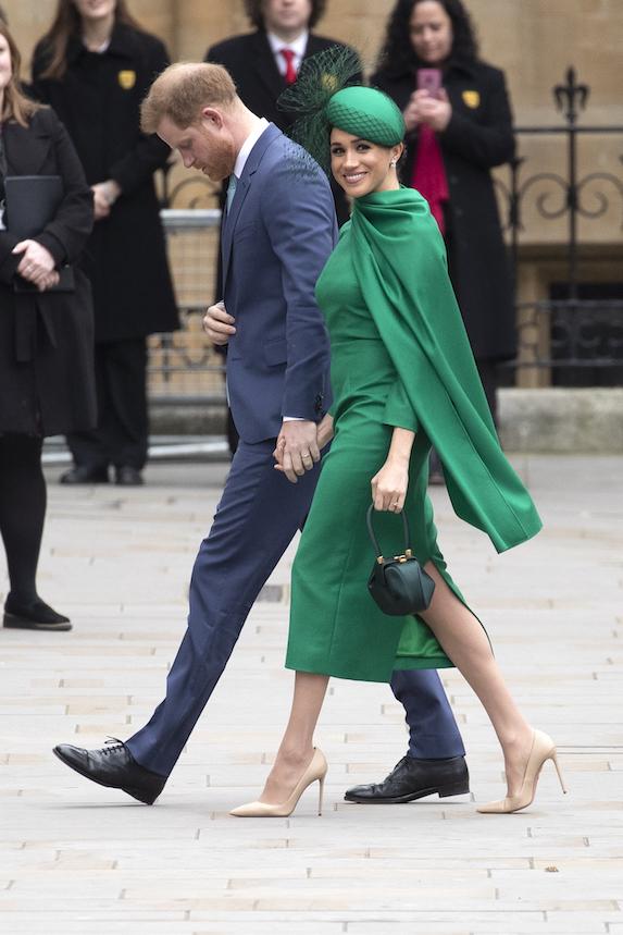 Meghan Markle wears a bright green ensemble as she walks alongside husband Prince Harry in 2020