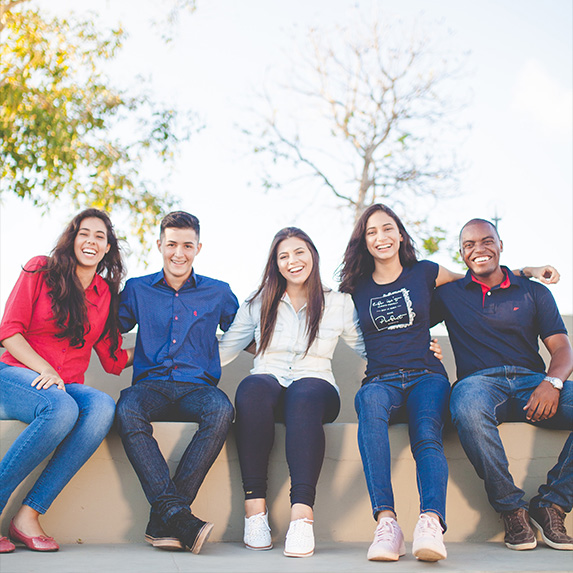 Group of friends sitting together smiling