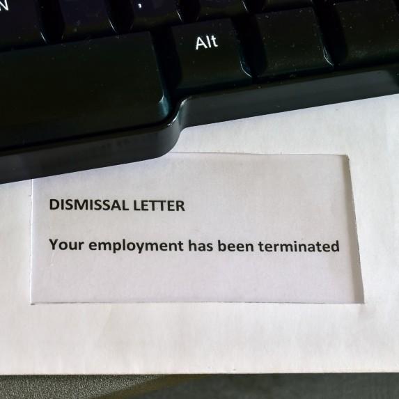 dismissal letter on keyboard