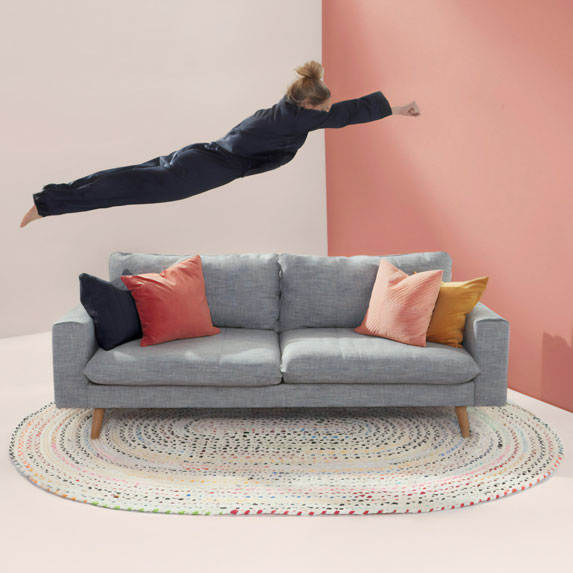 woman jumping onto a couch