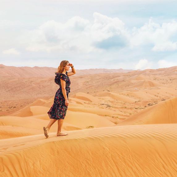 Woman in dress walking in the desert
