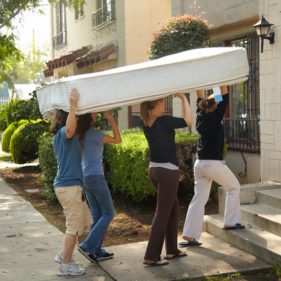 People moving a mattress