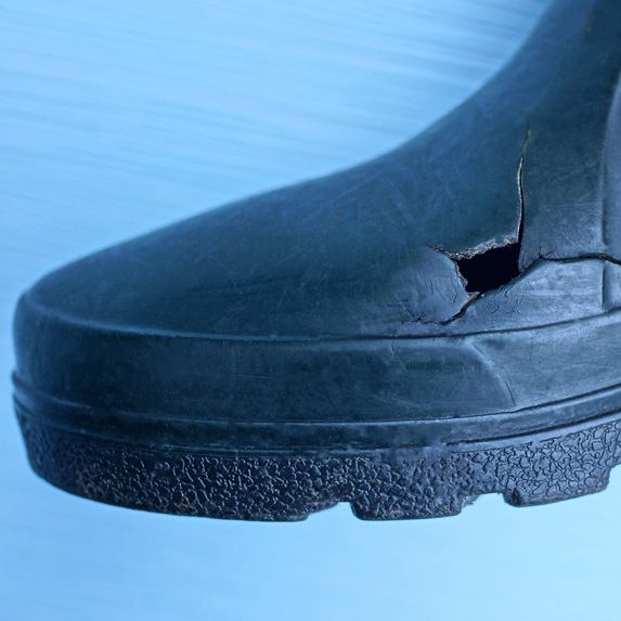 Rubber boot with hole