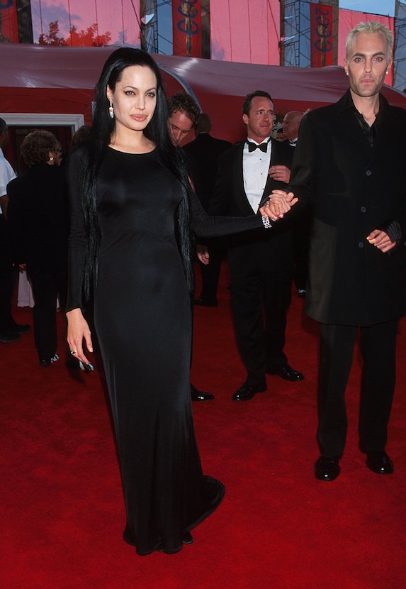 Angelina Jolie wears a black floor-length gown and long, black hair extensions to the 2000 Academy Awards
