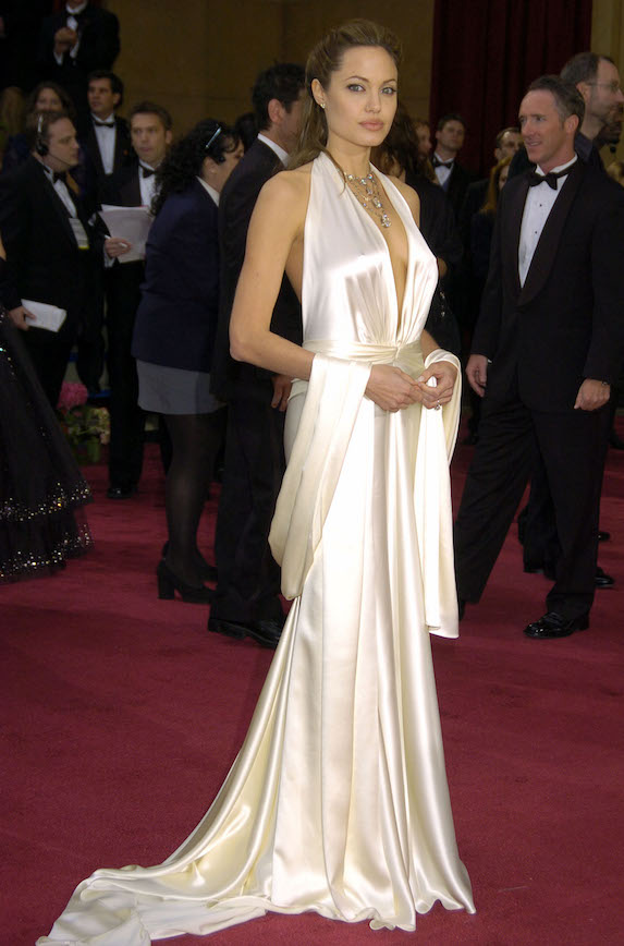 Angelina Jolie wears a floor-length satin gown to the Academy Awards in 2004