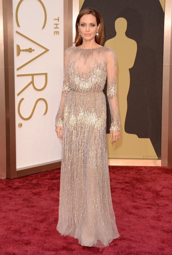 Angelina Jolie wears a floor-length, long-sleeve gown to the Academy Awards in 2014