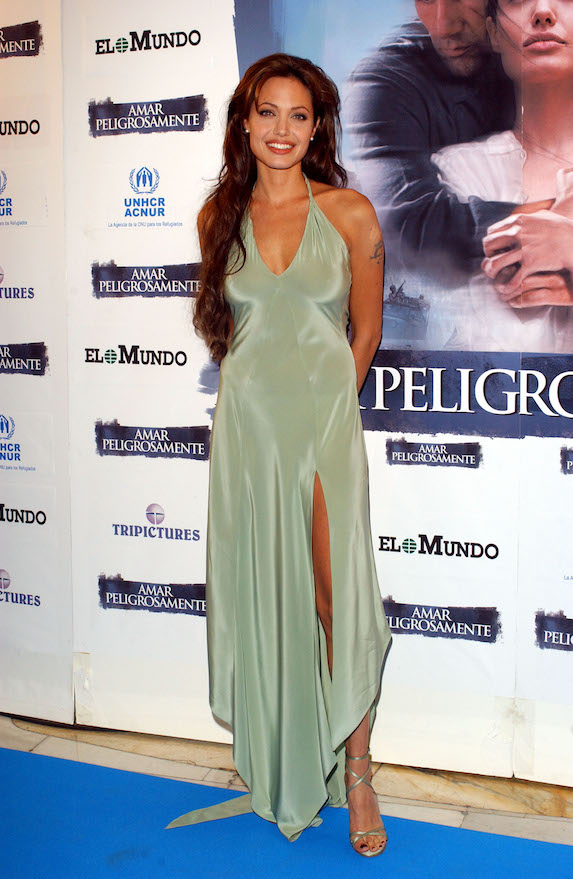 Angelina Jolie wears a silky halter-style gown to a film premiere in 2003