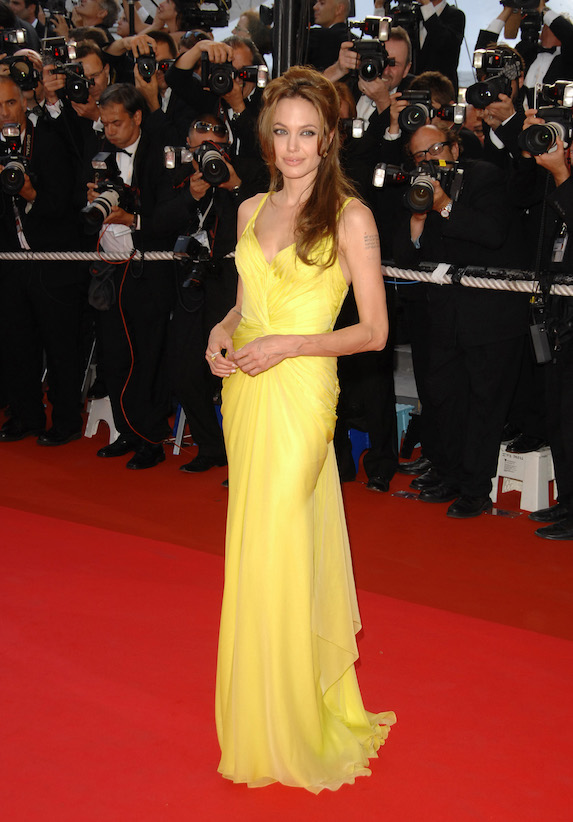 Angelina Jolie wears a bright yellow gown to a film premiere in Cannes in 2007