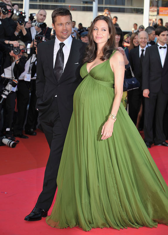 A pregnant Angelina Jolie walks the red carpet in Cannes in 2008 with Brad Pitt