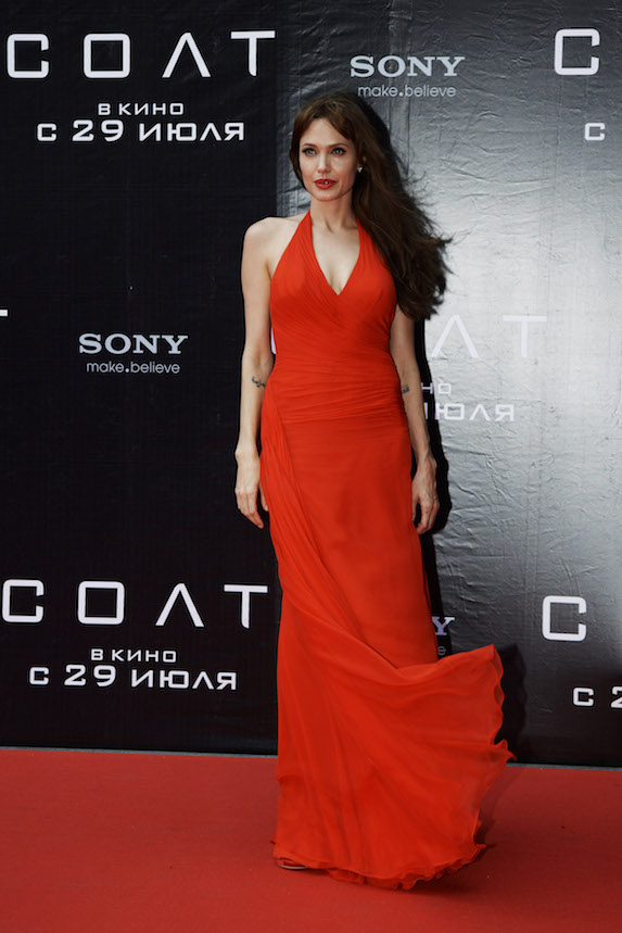 Angelina Jolie wears a red gown to a film premiere in 2010