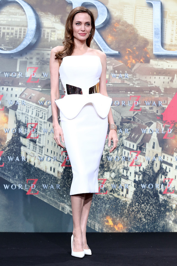Angelina Jolie wears a white peplum-style midi dress at an event in 2013