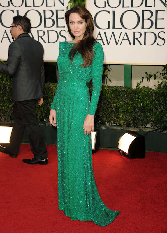 Angelina Jolie wears a sparkly emerald-green gown to the Golden Globe Awards in 2011